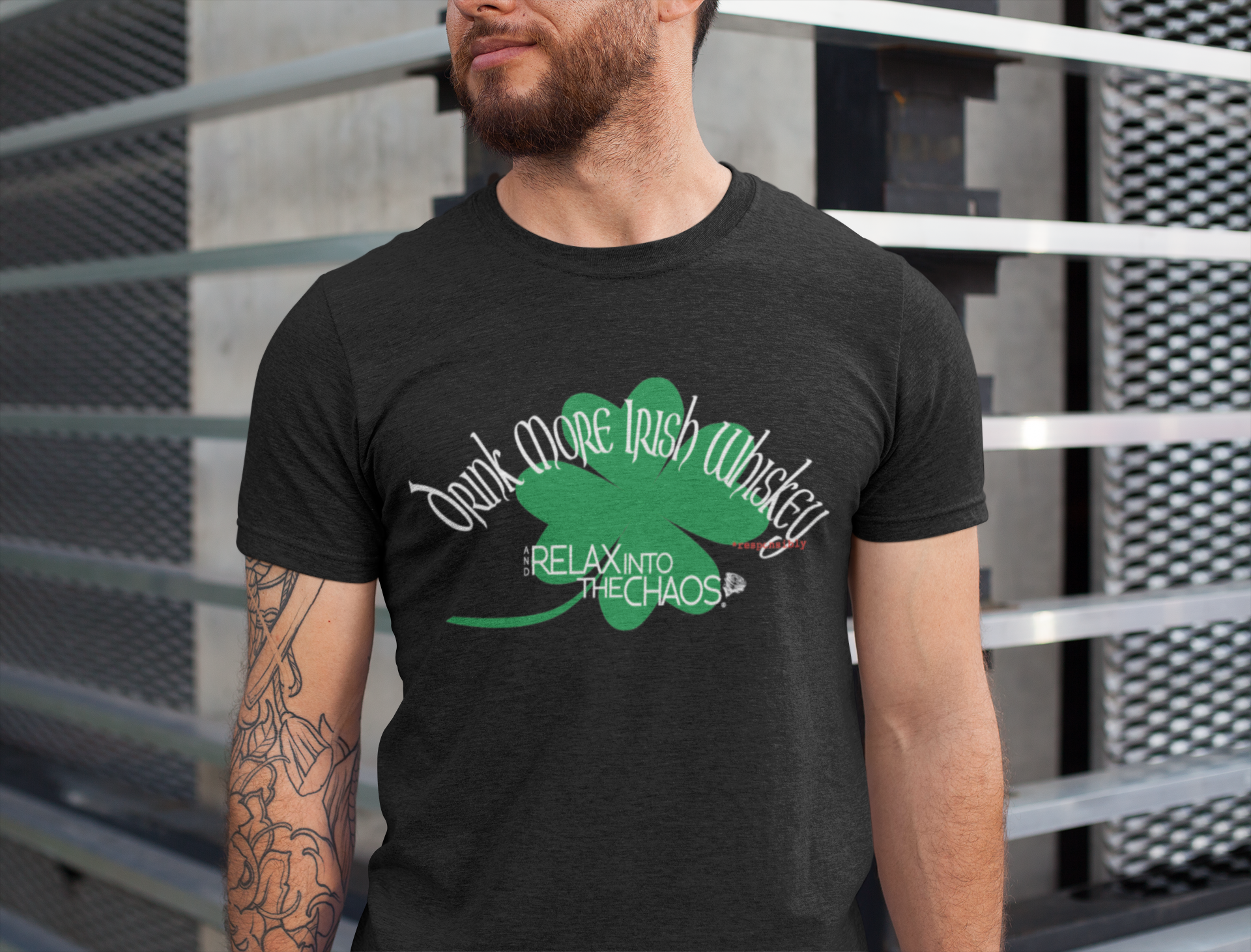 relax into the chaos organic t-shirt on man with-tattoos-on-one-arm